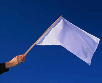 "In auto racing, a white flag means ""last lap"". --- Image by © Royalty-Free/Corbis"